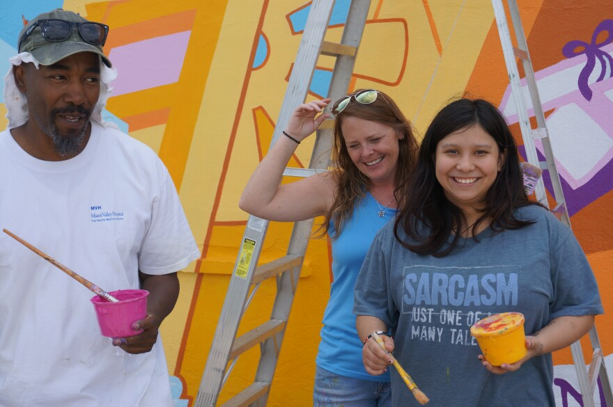 James Pate, Brittini Long, and Leo painting at the Wesley Community Center