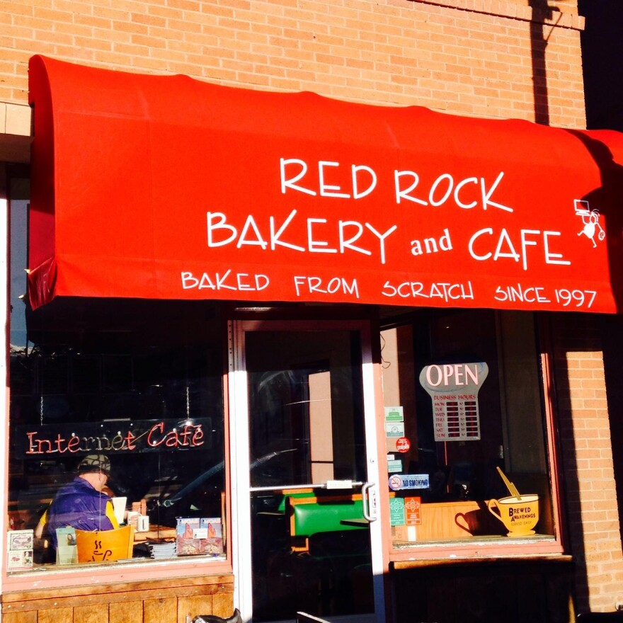 "Photo of a red awning over a shop window that reads ""Red rock bakery and cafe"""