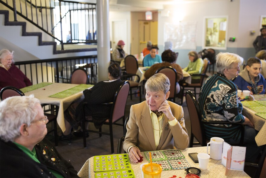 Debra Johnson talks with a friend while playing afternoon bingo at the Mary Ryder Home. (Jan. 4, 2017)