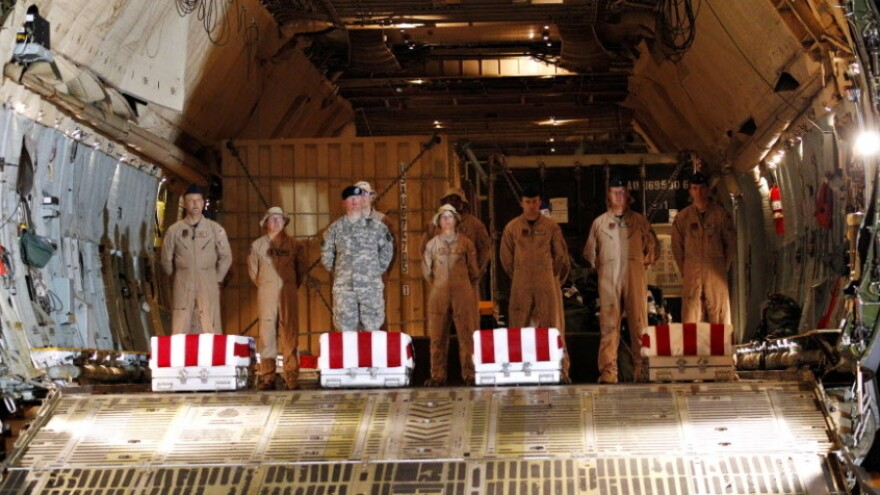 June 8, 2011: The coffins of four U.S. soldiers killed in Iraq arrive at Dover Air Force Base.