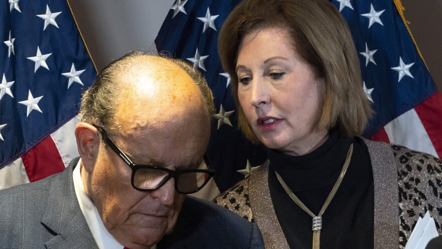 Rudy Giuliani, President Trump's personal attorney, with lawyer Sidney Powell at a press conference in Washington on Nov. 19. They are being sued, along with the Trump campaign and others, by an employee of Dominion Voting Systems, a vendor that has been the subject of disinformation from Trump and his allies.