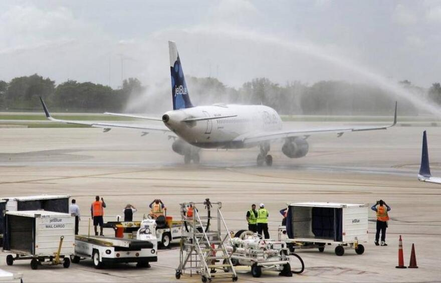 A JetBlue flight from Fort Lauderdale - the first U.S. commercial flight to Cuba in more than half a century - lands in Santa Clara in August 2016 to a water cannon salute.