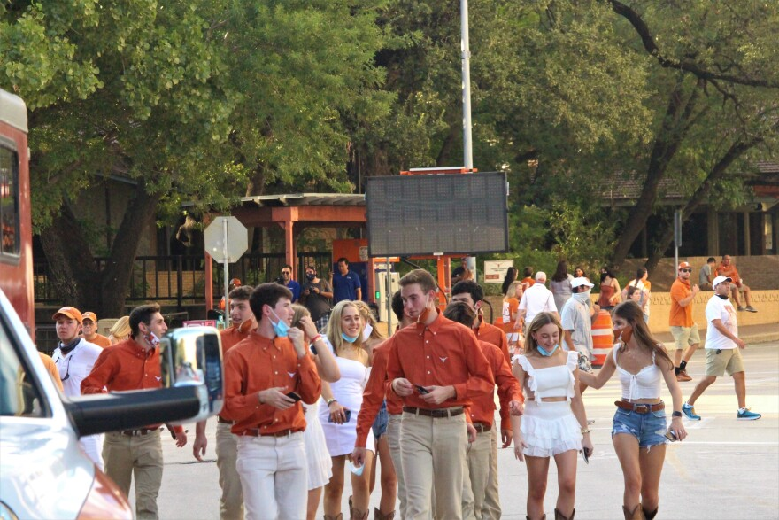 Students attend UT's first game of the 2020 season. The stadium's capacity is limited to 25% in accordance with state law, but only UT students had to test negative ahead of the game in order to attend.