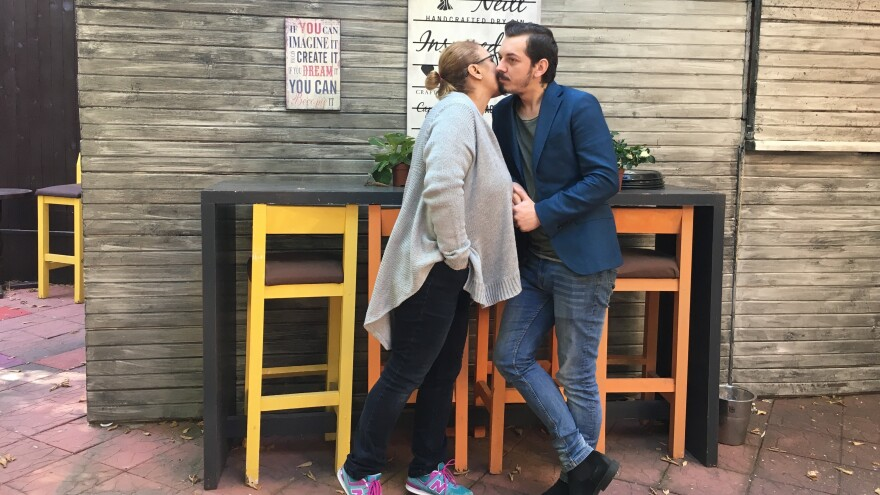 """""""In Romanian society, people are told 'the gays are taking over the country,' like we are something that's supposed to be feared,"""" says Alex Andronic, pictured above with Mihaela Balan in their bistro-pub, Blueberry, one of the few gay-friendly establishments in Bucharest."""