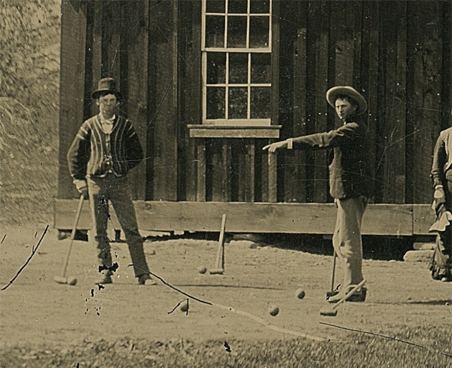 A detail of Billy the Kid (left) in the original tintype.