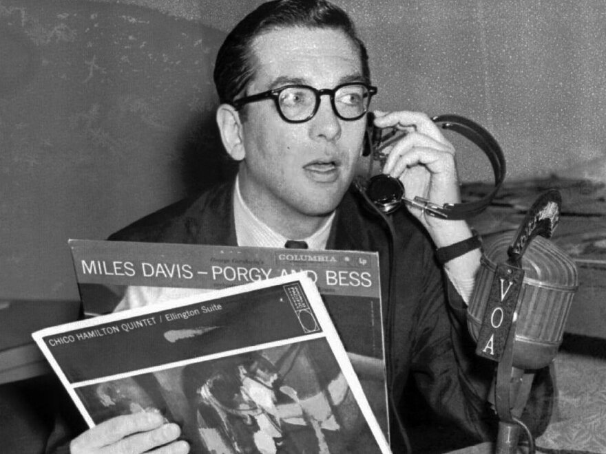 """Willis Conover, an expert on jazz, broadcasts """"Music USA"""" from his Voice of America studio in Washington in March 1959."""