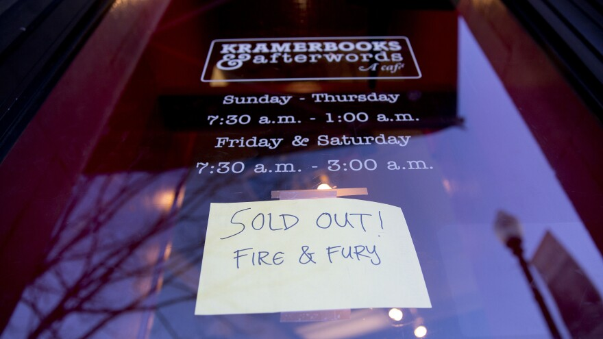 A sign posted at the door of Kramerbooks & Afterwords Cafe in Washington, D.C., announced that <em>Fire and Fury: Inside the Trump White House</em> was already sold out on Friday.