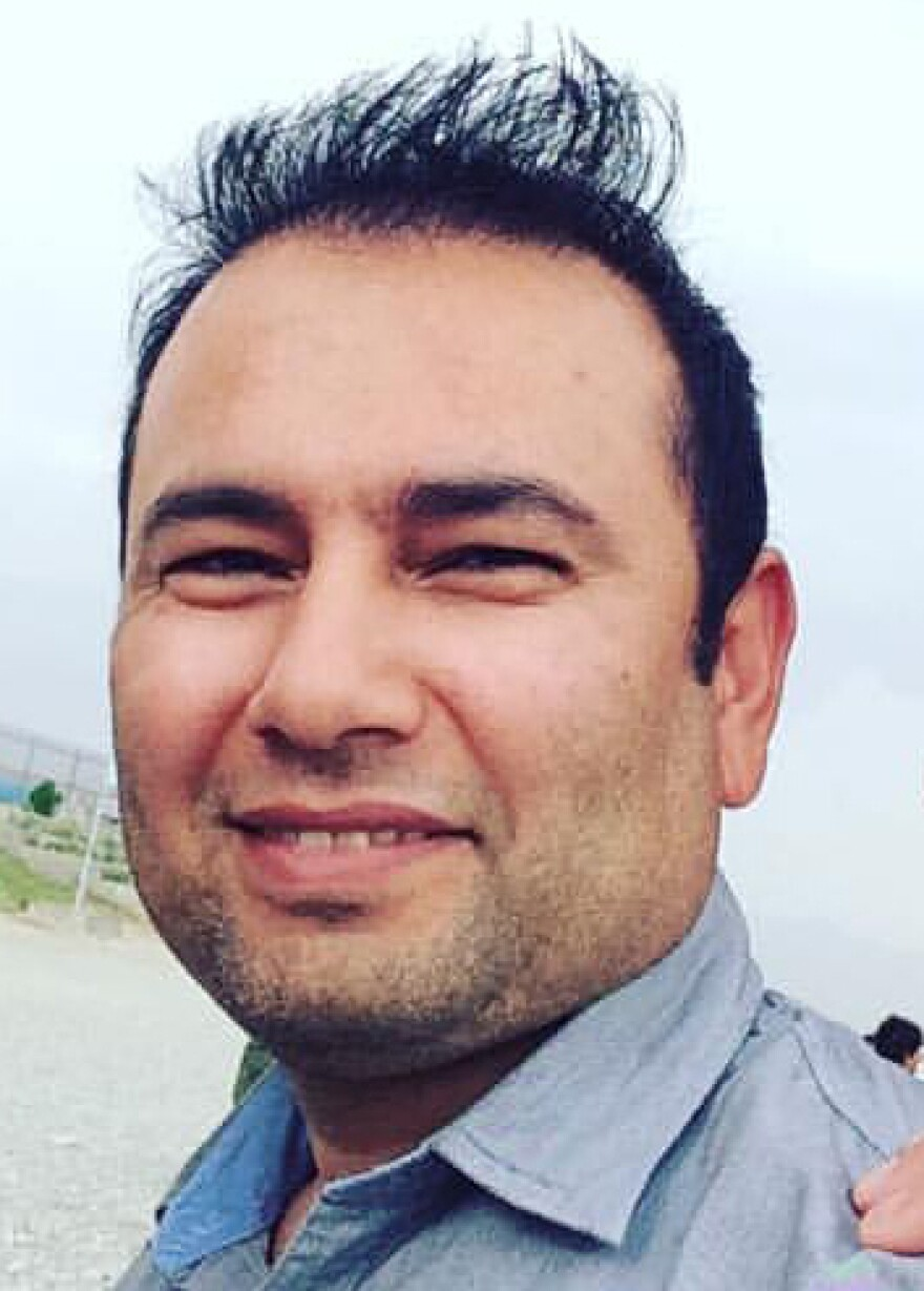 Zabihullah Tamanna, shown here in Afghanistan on June 2, was an accomplished journalist and a father of three.