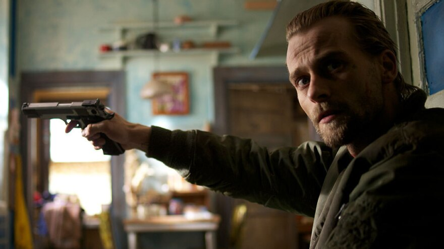 Joe Anderson plays Garrett Tully, a recently paroled white supremacist, in Deon Taylor's <em>Supremacy. </em>The film is based on the true story of Robert Scully, who was released from prison in 1995 and, days later, killed a police officer and took a black family hostage.