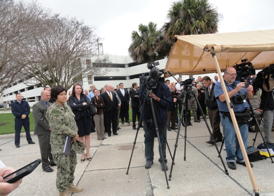 About 100 people turned out under gray skies for the groundbreaking.