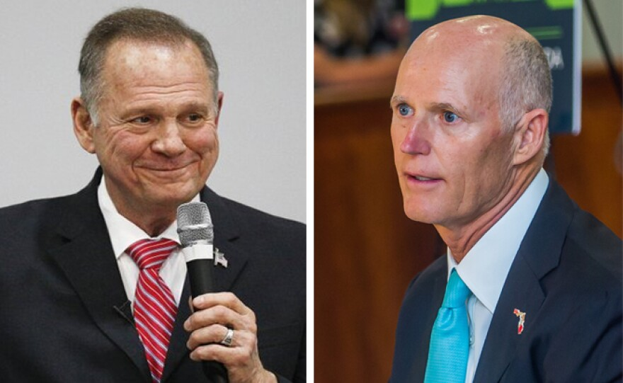 Fla. Gov. Rick Scott (right) is calling on Roy Moore (left) to drop out of Alabama's U.S. Senate race.