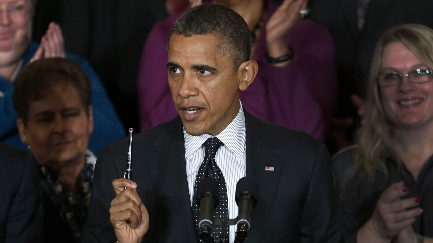 President Obama speaks about the economy and the deficit Friday in the East Room of the White House.