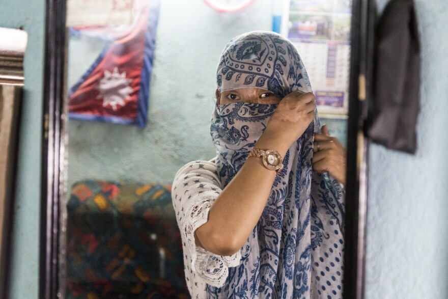 Sangita Magar always covers her face with a scarf and large sunglasses before leaving home. She says she's comfortable with her scars but doesn't like to deal with people staring.