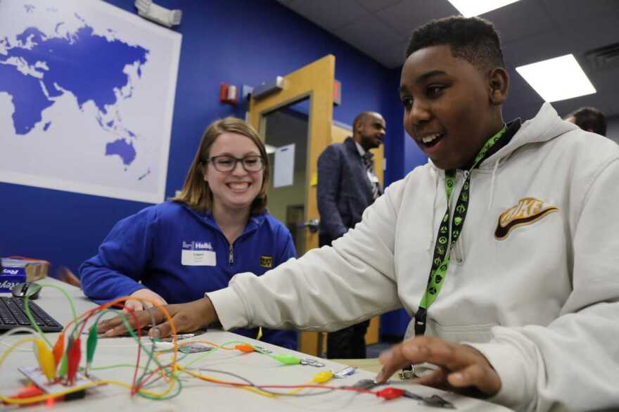 A teen learns about circuitry while building a game controller at the Best Buy Teen Tech Center in Indianapolis.