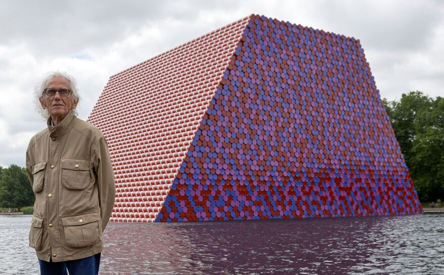 Bulgarian artist Christo Vladimirov Javacheff, better known as Christo, poses for a photograph as he unveils <em>The Mastaba</em> on the Serpentine lake in Hyde Park in London on June 18, 2018.