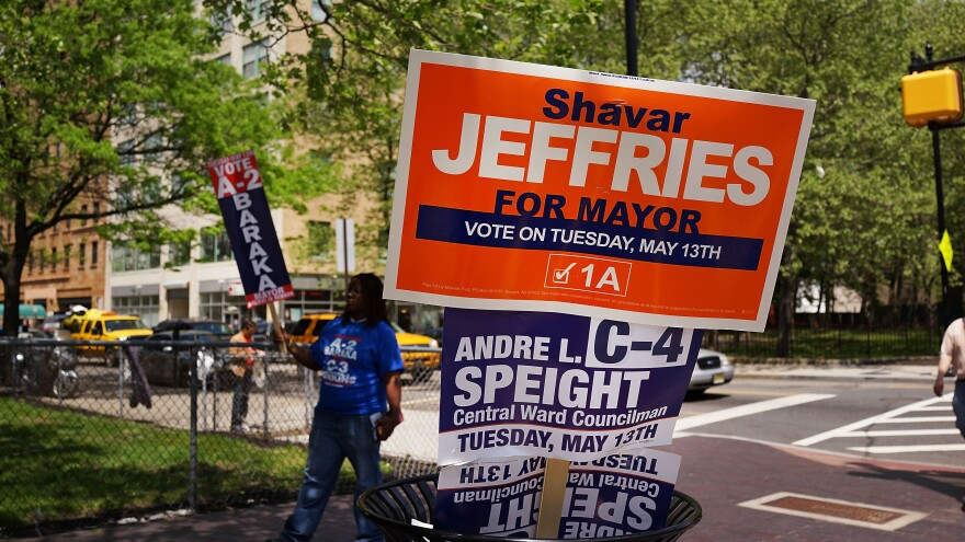 Jeffrey Heffernan says he was demoted after he picked up a replacement campaign sign for his bedridden mother.