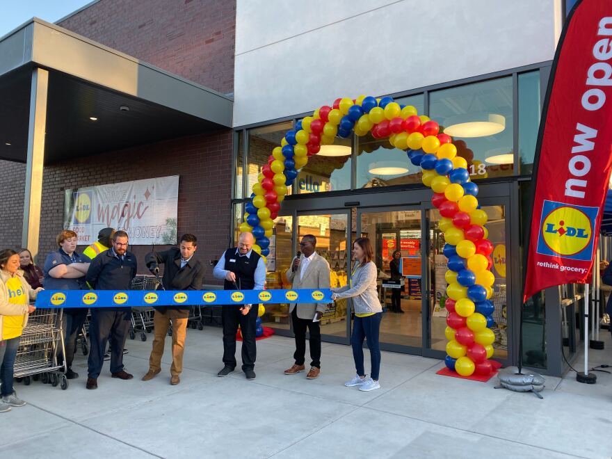 City Council member Tariq Bokhari and Lidl store manager Derek Fernandez cut the ribbon to open the new Lidl store on Monroe Road on Dec. 4, 2019..