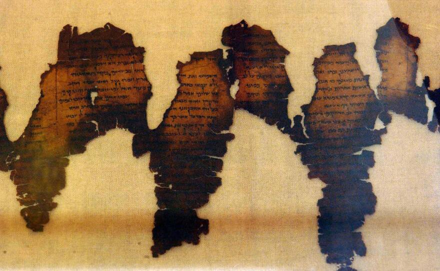 Fragments of the Dead Sea Scrolls are displayed in 2003 at Montreal's Pointe-a-Callieres archaeology museum. Five forged fragments of the scroll were previously displayed at the Museum of the Bible.