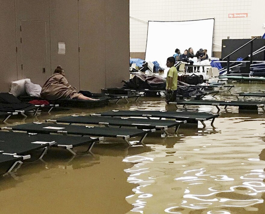 People in the Bob Bowers Civic Center, meant to be a shelter in Port Arthur, Texas, were surrounded by floodwaters caused by Tropical Storm Harvey, in this photo provided by Beulah Johnson.