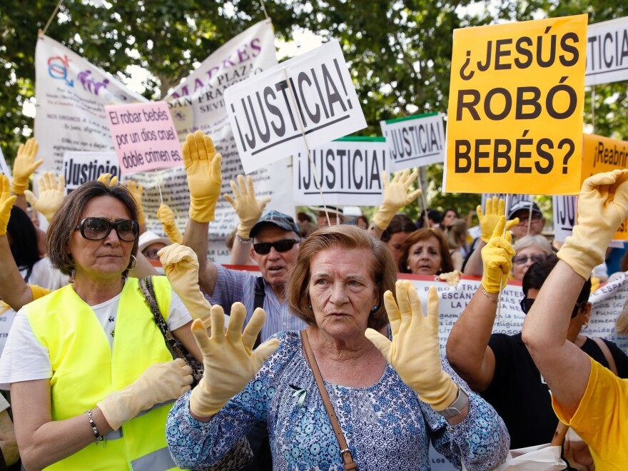 Demonstrators gather Tuesday outside the Madrid courtroom where Eduardo Vela is being tried.