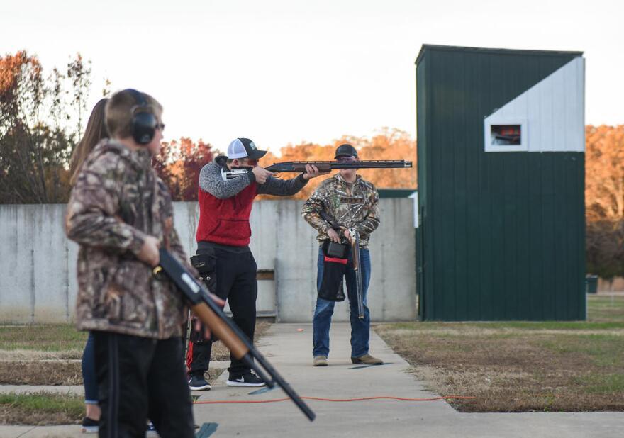Garret Cooper, 15, center, raises his shotgun during a round of trapshooting at the Poplar Bluff Gun Club in Poplar Bluff, Missouri in November. The Poplar Bluff High School team is one of nearly 80 school-supported organizations in Missouri that received