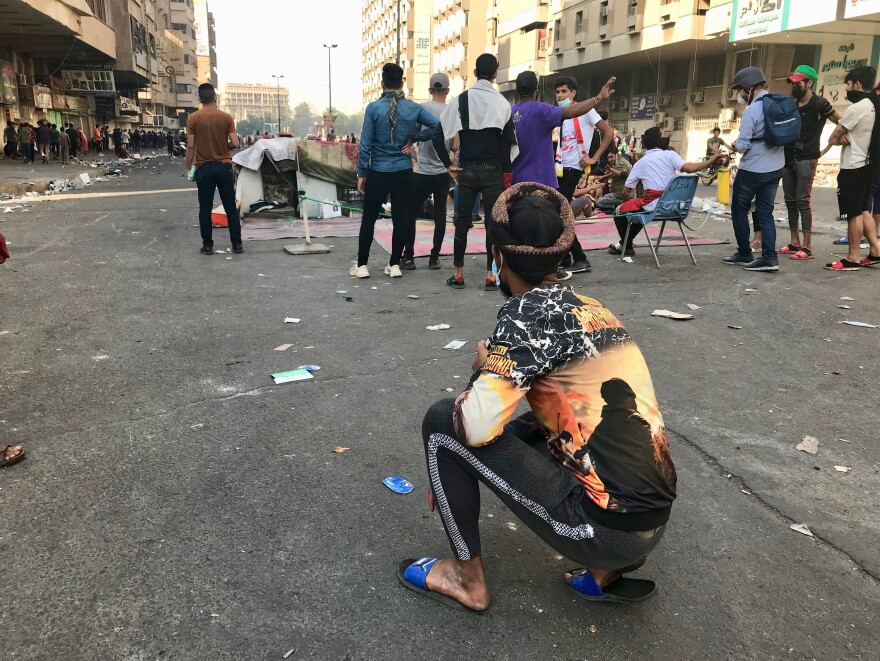 Protesters near Al Khalani Square in central Baghdad, moments before security forces opened fire to disperse the demonstrators.