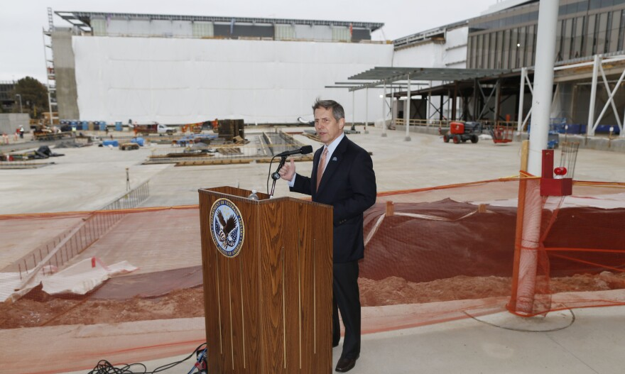Sloan Gibson, deputy secretary of Veterans Affairs, speaks in April at the construction site of the VA hospital in Aurora, Colo. The unfinished hospital is more than $1 billion over its original budget and congressional funding runs out this week.