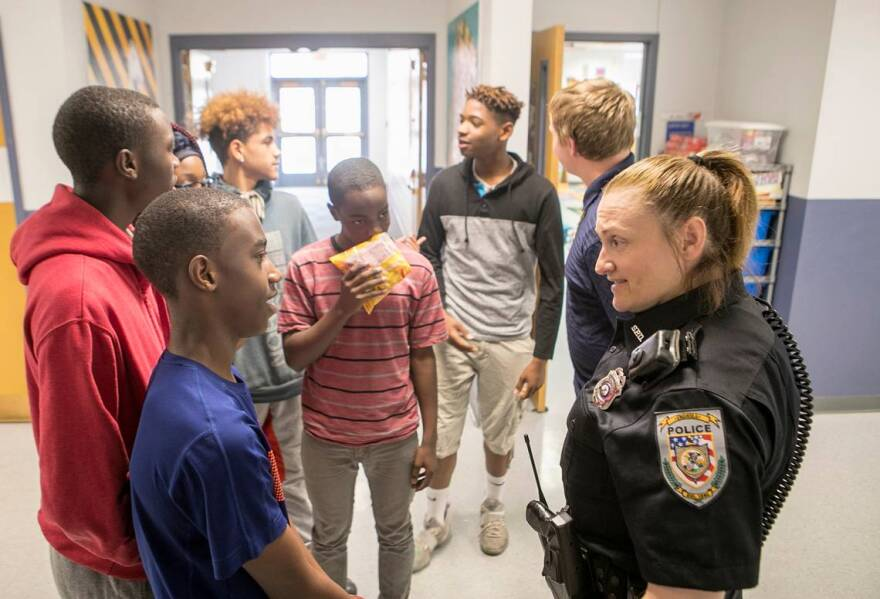 School resource officer Cheryl Venorsky talks with several of the older High Mount School students.