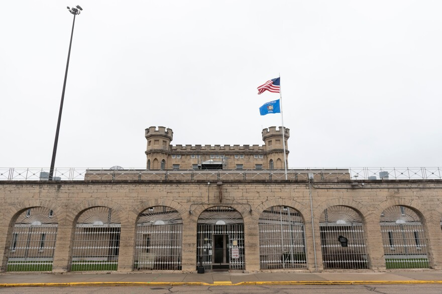 Limestone brick archways mark Waupun Correctional Institution's main entrance. Many rural, predominantly white prison towns see their population numbers boosted by prison populations disproportionately made up of black and Latinx people.