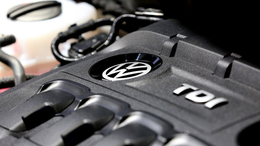 A longtime Volkswagen engineer has pleaded guilty to conspiracy charges as part of a deal with prosecutors. Here, the Turbocharged Direct Injection (TDI) engine of a Volkswagen vehicle is seen.