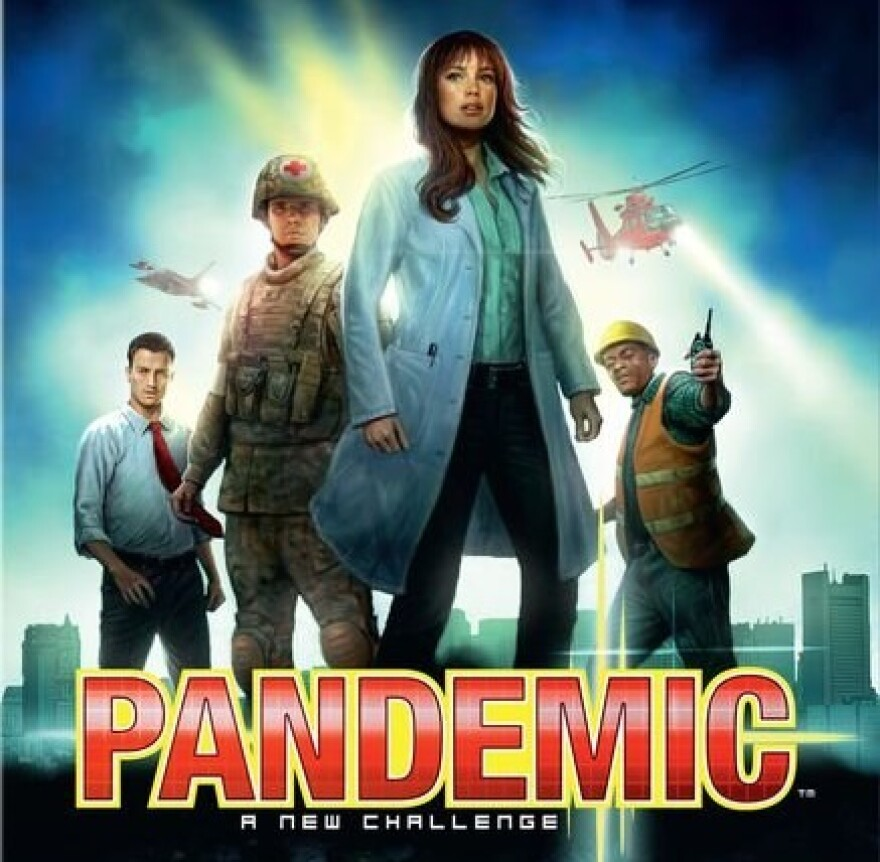 The box cover for the board game Pandemic features four people, a woman and three men with a city skyline behind them and two helicopters in the sky behind them.