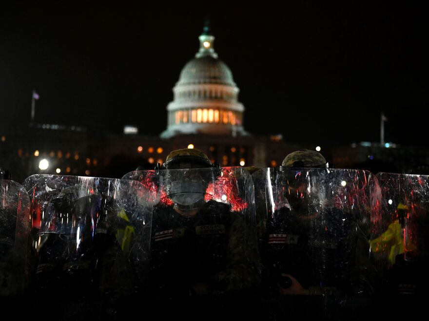 Members of the D.C. National Guard are deployed outside of the U.S. Capitol on Wednesday evening. Supporters of President Trump stormed a session of Congress earlier Wednesday.