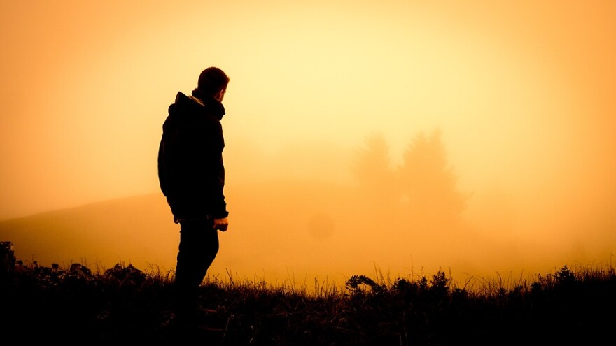 man_in_fog_at_sunset.jpg