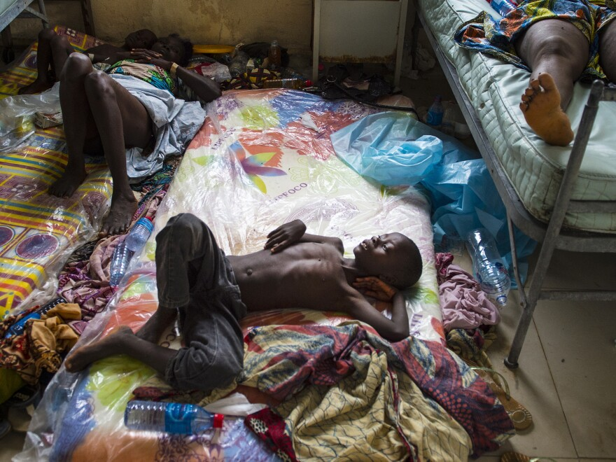 A boy lies on a mattress on the floor of Redemption Hospital, a holding center for Ebola patients in Monrovia, Liberia.