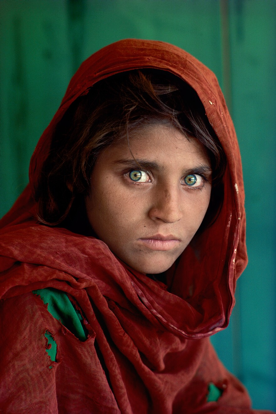 """Sharbat Gula was around 12 years old when photographer Steve McCurry took her picture. """"It was this piercing gaze,"""" McCurry says. """"A very beautiful little girl with this incredible look."""""""