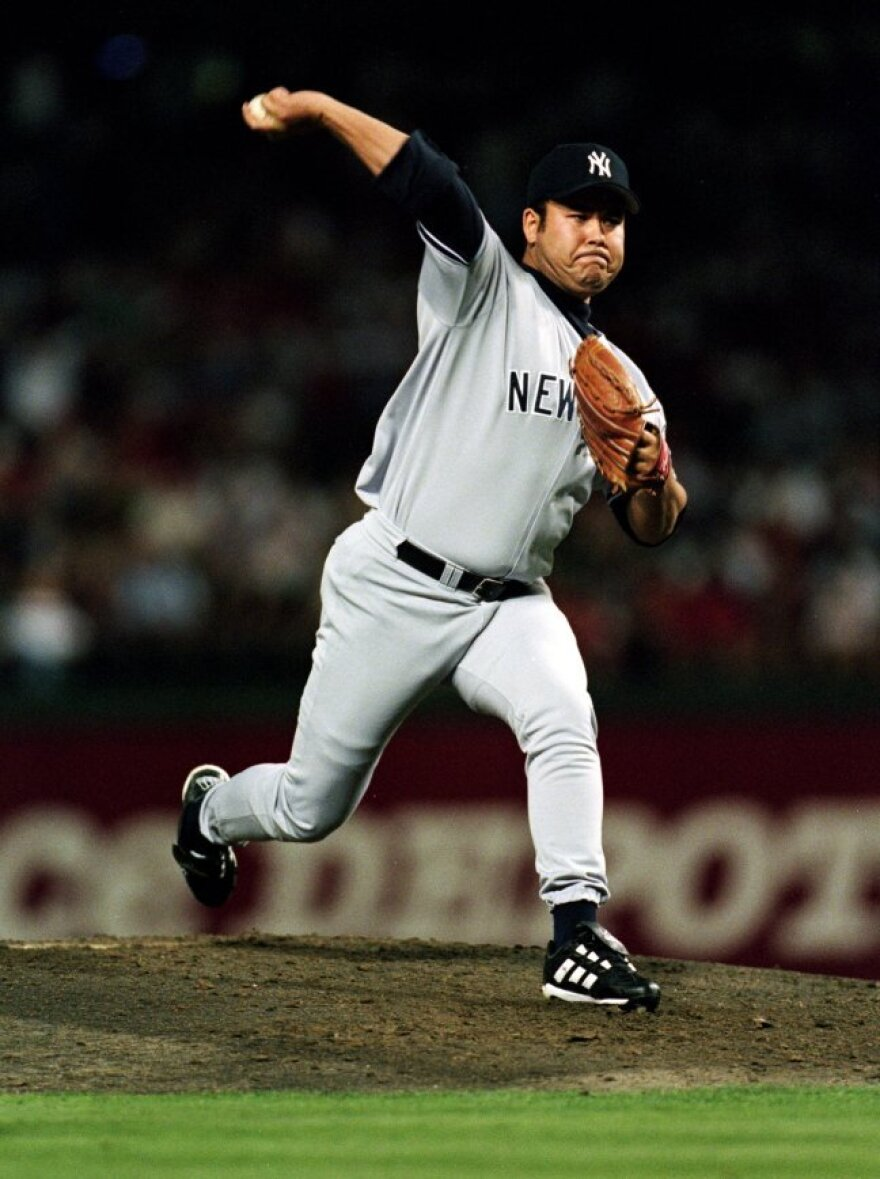 Hideki Irabu pitches for the New York Yankees in a 1999 game against the Texas Rangers.