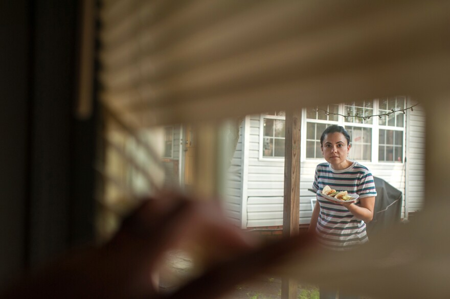 My wife, Marisol Doyle, brings dinner tacos to the front door of our tiny guesthouse, where I was self-quarantining. Marisol would deliver fresh food as often as she could, and we would eat meals together on FaceTime. <em>March 26, 2020, Cleveland, Miss.</em>