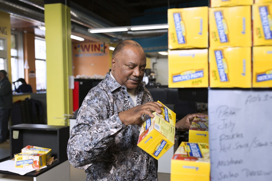 Sterling Moody re-arranges shelves at Neighbors' Market, his new East St. Louis grocery store. April 6, 2018.