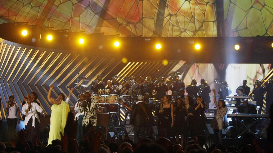Aretha Franklin, left in yellow, on stage with The Clark Sisters at the 50th Grammy Awards in Los Angeles on February 10, 2008.