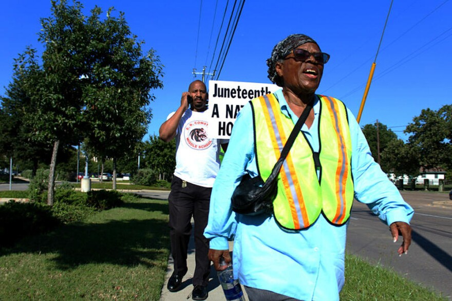 Opal Lee plans to turn 90 on her walk to the nation's capital. Behind her is Willie Johnson, principal of E.B. Comstock Middle School in Dallas, who joined her for a leg of the walk. (Christopher Connelly/KERA News)