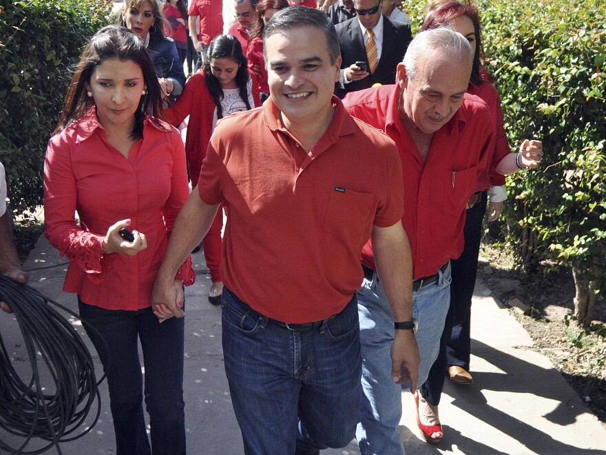 Yani Rosenthal (center), pictured in 2012, has been indicted along with nine other men and charged by the U.S. with laundering drug money. He is a member of one of the richest and most politically powerful families in Honduras.