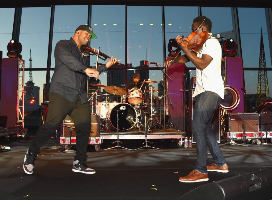 Kev Marcus (L) and Wil B (R) of Black Violin perform onstage during day one of the IEBA 2016 Conference in Nashville, Tennessee.