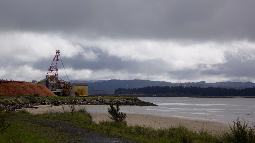Photo of Coos Bay with crane in background.