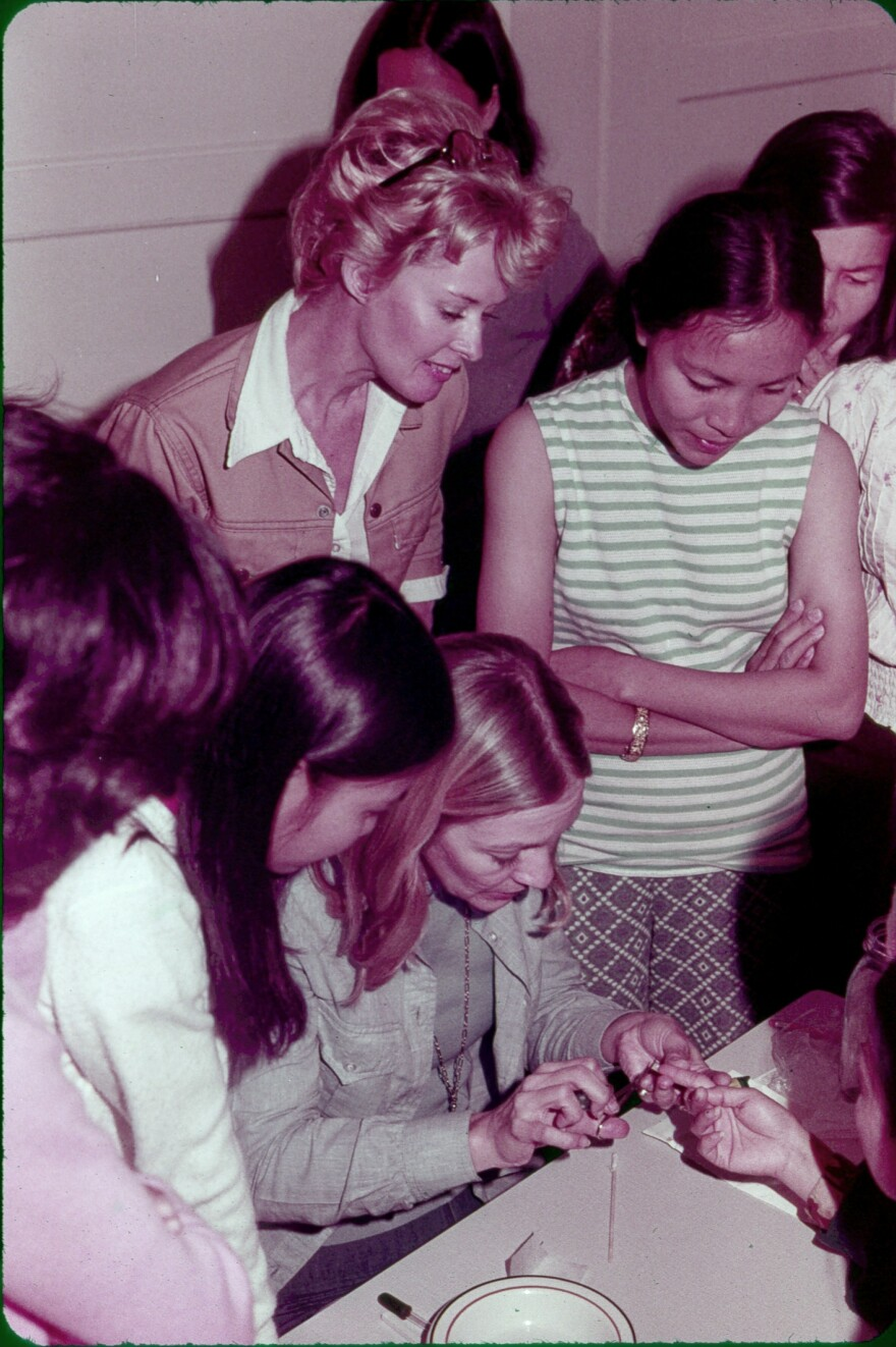 In 1975, actress Tippi Hedren (standing, left) brought her personal manicurist, Dusty Coots, to teach her trade to a group of 20 Vietnamese women in a California refugee camp.