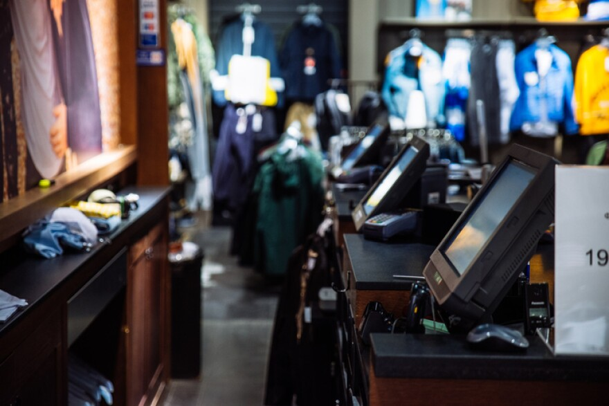 Bank of cash registers at a clothing retail store.