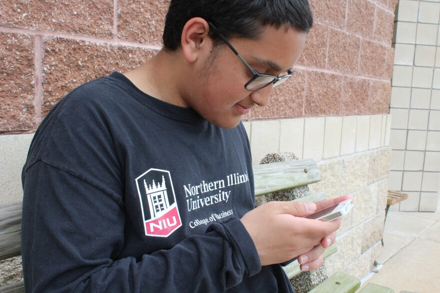 Fourteen-year-old Asad Siddiqui reads a reporter the text message he sent to a friend explaining the Ramadan fast.