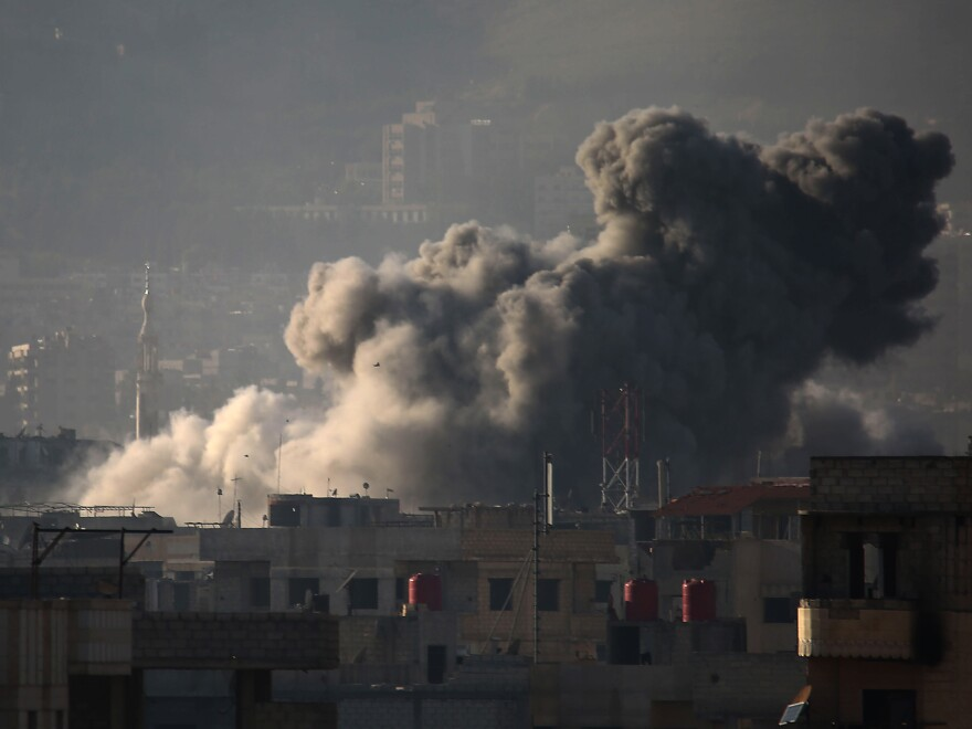 Smoke billows into the sky above eastern Ghouta after a wave of airstrikes Monday. Over the past month, the region of nearly 400,000 has seen its deadliest spasm of violence in years.