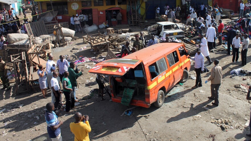"""Security officers patrol the scene of an explosion aboard a minibus in the Gikomba market area of Nairobi, Kenya, on May 16. The Kenyan capital was hit by two explosions that day --€"""" a day after Western tourists were evacuated from Mombasa."""