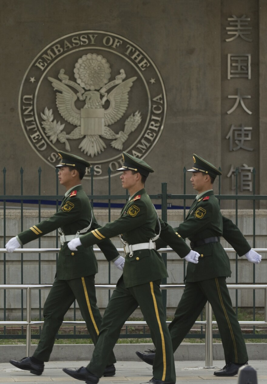 Chinese paramilitary police patrol outside the U.S. Embassy in Beijing on April 28. Chen Guangcheng, a blind legal activist who fled house arrest in his rural Chinese village, is reported to be under the protection of U.S. officials. Secretary of State Hillary Clinton is heading to China for what was supposed to be a routine visit.
