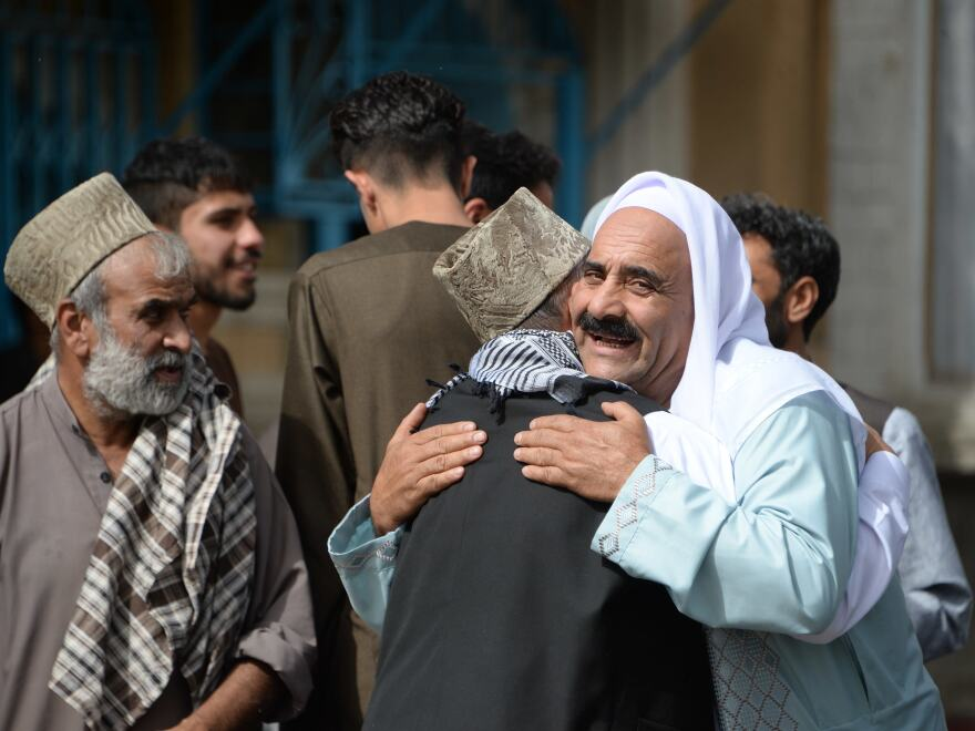 Afghan Muslims celebrated the start of the Eid al-Fitr holiday on Friday. An attack on Saturday disturbed the peace, leaving dozens of casualties.